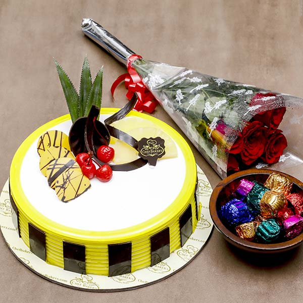 Pineapple One kg Cake With 5 Red Roses and Chocolates